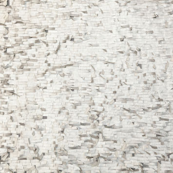 Metallic Silver Faux Leather Fringe Fabric on a White Mesh Backing