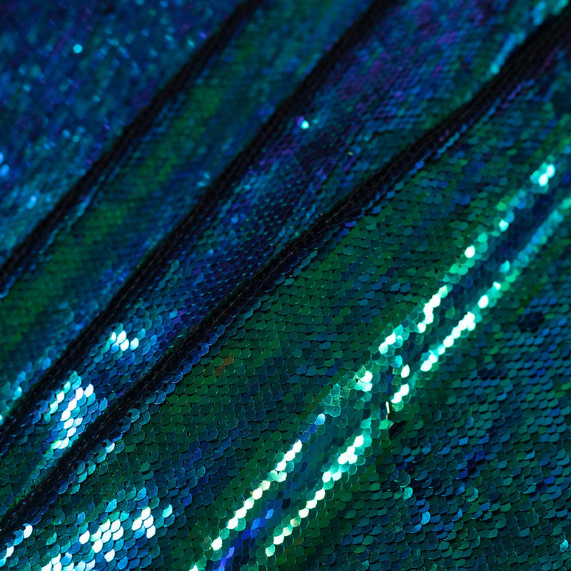 Green and Blue Iridescent Two-Toned Paillette Sequins on a Stretch Backing - Folded