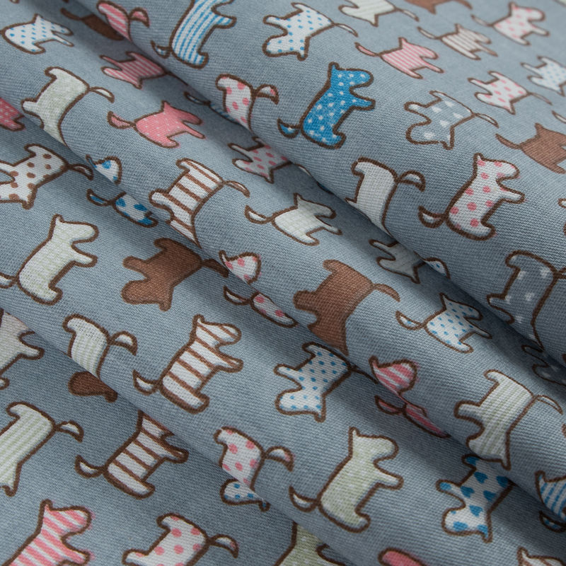 Fog Blue/Multi-colored Patterned Dogs Printed on a Cotton Twill - Folded