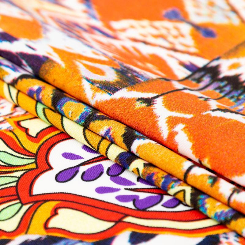 Orange Abstract Ikat and Floral Stretch Polyester Jersey - Folded